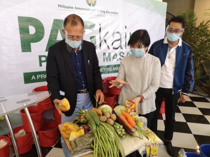 PAGCOR officials pool funds to provide meals to low-income families
